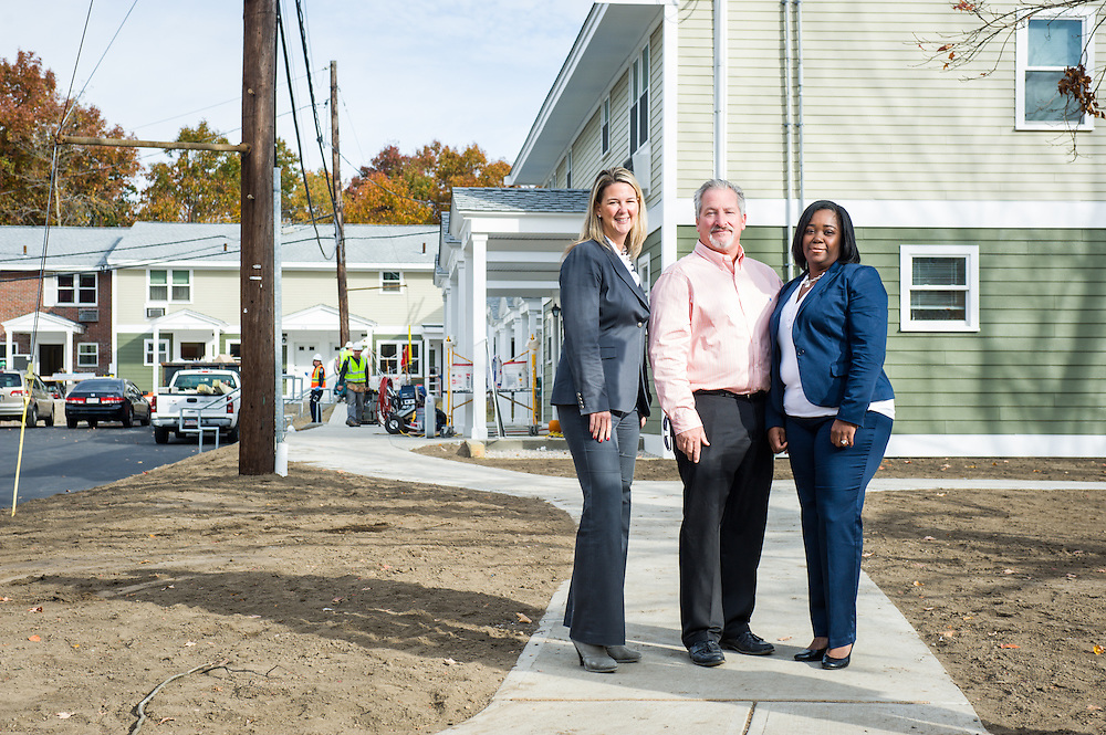 Beacon Communities Director of Construction and Special Projects Kevin Donovan, Senior Property Manager Kate Joyce, and Regional Vice President Toya Irish photographed for the Mass Housing Annual Report at Georgetowne Homes in Hyde Park.