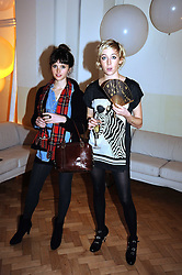 Left to right, actress FELICITY JONES and playwright POLLY STENHAM at Vogue's Fantastic Fashion Fantasy Party in association with Van Cleef & Arpels to celebrate Vogue's Secret Address Book held at One Marylebone Road, London NW1 on 3rd November 2008.
