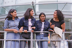 Group of teenage girls in town on shopping trip,