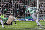 16.03.2013 Glasgow, Scotland.  Gary Hooper grabs the ball out of the net   during the Clydesdale Bank Premier League match between, Celtic and Aberdeen, from Celtic Park Stadium.