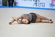Rizatdinova Anna during final at ribbon in Pesaro World Cup at Adriatic Arena on April 27, 2013. Anna was born July 16, 1993 in Simferopol, she is a Ukrainian individual rhythmic gymnast.