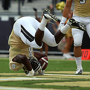 UCF Knights running back Storm Johnson (8) rolls onto his head while scoring a touchdown during an NCAA football game between the South Carolina Gamecocks and the Central Florida Knights at Bright House Networks Stadium on Saturday, September 28, 2013 in Orlando, Florida. (AP Photo/Alex Menendez)