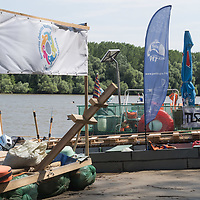 Boats used by volunteers of the PET Cup plastic waste recovery challenge to collect trash from river Tisza in Dombrad, Hungary on Aug. 5, 2020. ATTILA VOLGYI