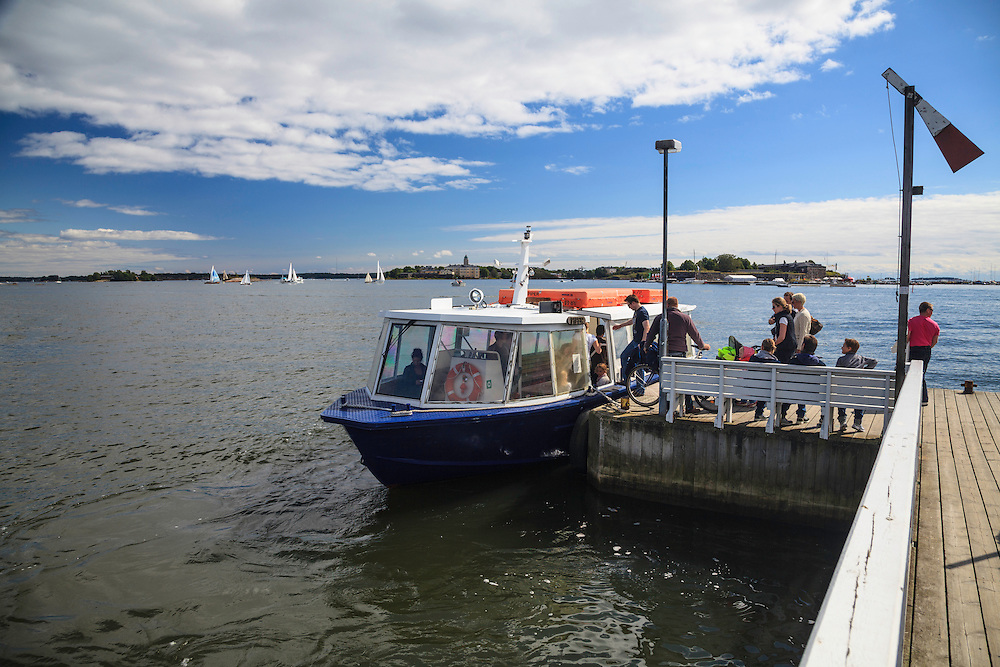 An island connection ferry in Helsinki, Finland.  If someone needs a ferry he raises the red sign so that a skipper can see that transport is needed.