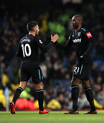 West Ham United's Angelo Ogbonna (right) celebrates scoring his side's first goal of the game with team mate Manuel Lanzini (left) during the Premier League match at the Etihad Stadium, Manchester.