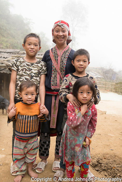 Man May Lo's family in  village Giang ta chai of the Red Dao hill tribe people outside of Sapa, Northern hill tribe areas, Vietnam