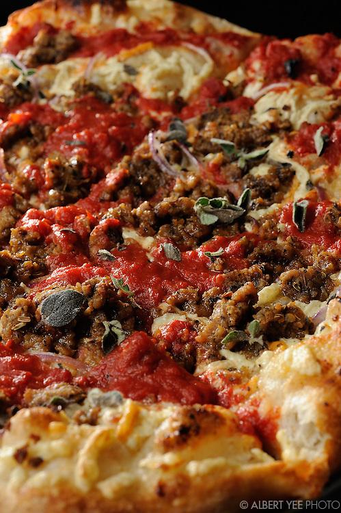 Haymaker: seitan sausage, red onions, garlic butter, tomato sauce, daiya cheese, fresh oregano<br /> <br /> Blackbird Pizzeria<br /> <br /> for Grid Magazine<br /> <br /> Feburary 21, 2014