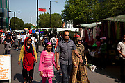 People from various ethnic backgrounds around the market on Whitechapel High Street in East London. This area in the Tower Hamlets is predominantly Muslim with just over 50% from Bangladeshi descent. This is known as a very poor area of London's East End.