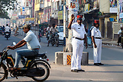 An Indian policeman directing traffic wearing the French style uniform and Kepi hat, Pondicherry, India. Pondicherry now Puducherry is a Union Territory of India and was a French territory until 1954 legally on 16 August 1962.
