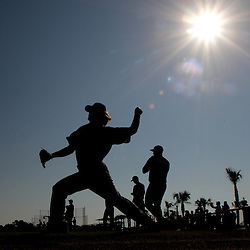 February 20, 2011; Port Charlotte, FL, USA;  Tampa Bay Rays pitcher J.P. Howell (front) throws with teammates during spring training at Charlotte Sports Park.  Mandatory Credit: Derick E. Hingle