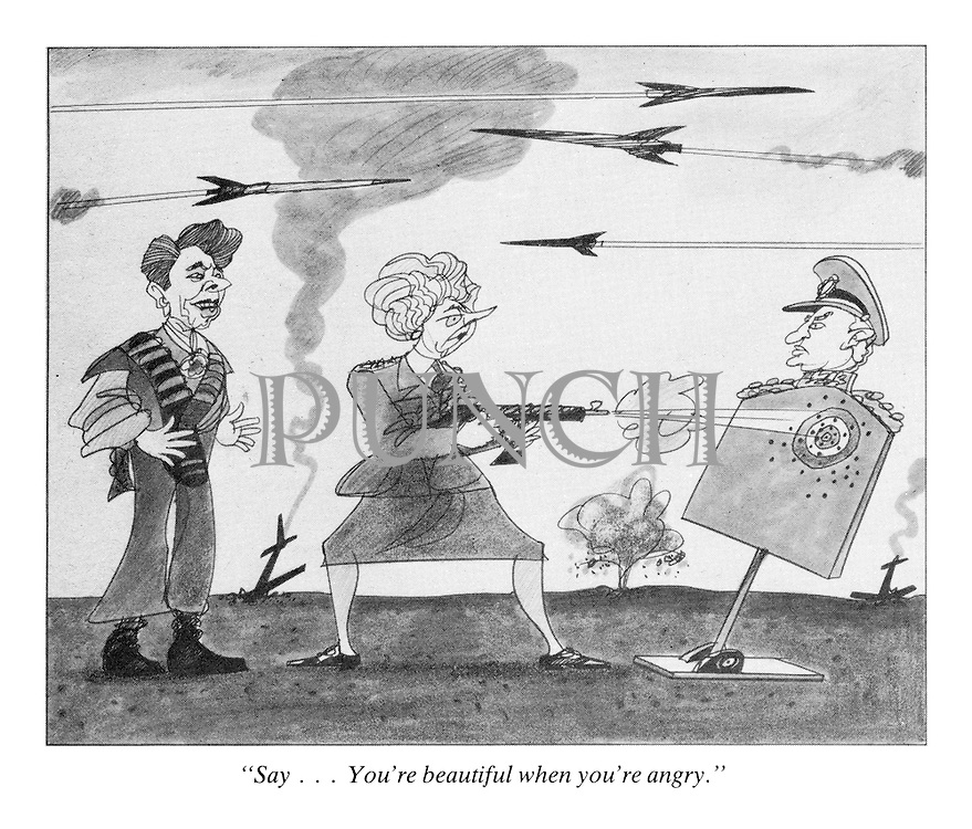 """Say...You're beautiful when you're angry."" (a 1980s cartoon from Punch shows President Ronald Reagan on battle training as Prime Minister Margaret Thatcher shoots a machine gun at a target of a Soviet leader Yuri Andropov and nuclear rockets fly overhead)"