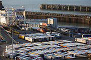 As incoming lorries disembark from the ferry other lorries line up ready for departure inside the Eastern Dock of the Port of Dover is where the cross channel port is situated with ferries departing here to go to Calais in France on the 29th of January 2020 in Dover, Kent, United Kingdom. Dover is the nearest port to France with just 34 kilometres 21 miles between them. It is one of the busiest ports in the world. As well as freight container ships it is also the main port for P&O and DFDS Seaways ferries.