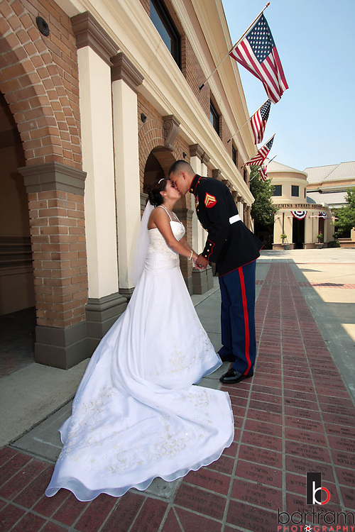 Photo by Kevin Bartram.Ordaz-Duenas 7/12/08.Bianca and Salvador Duenas kiss following their wedding in Lodi, California on Saturday, July 12, 2008. Salvador is in the Marine Corps and has served in Iraq.
