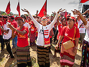 01 NOVEMBER 2015 - YANGON, MYANMAR: Women dance at the NLD's last election rally of the 2015  election in the Yangon suburbs Sunday. Political parties are wrapping up their campaigns in Myanmar (Burma). National elections are scheduled for Sunday Nov. 8. The two principal parties are the National League for Democracy (NLD), the party of democracy icon and Nobel Peace Prize winner Aung San Suu Kyi, and the ruling Union Solidarity and Development Party (USDP), led by incumbent President Thein Sein. There are more than 30 parties campaigning for national and local offices.    PHOTO BY JACK KURTZ