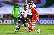 Trinidad and Tobago midfielder Levi Garcia goes past Wales forward forward Tyler Roberts during the Friendly European Championship warm up match between Wales and Trinidad and Tobago at the Racecourse Ground, Wrexham, United Kingdom on 20 March 2019.