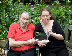 A carer from Highbury East, North London, has been recognised by the British Caregiver Award, a scheme set up by National Accident Helpline designed to shine a light on the amazing dedication shown by the UK's 5.8 million unpaid carers.<br /> <br /> Anne Couzens, 37, cares for her father Barry, 69. Ann has been awarded a trophy and £100 as one of 11 special recognition awards. Pictured in St. Luke's Garden adjacent to Ironmongers Row Baths Islington where  Barry has been the chair of the Optimists Swimming Club for the past 25 years. <br /> <br /> 19th June 2016