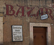 Dentist office signs in spanish on an old Bazar building in the central highland city of Morelia, Michoacan state Mexico. The city is a UNESCO World Heritage Site and hosts one of the best preserved collection of Spanish Colonial architecture in the world.