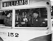 Y-480127-03.  Bus 152, Williams Avenue bus, trolley bus, electric wires, passengers boarding, driver at wheel.