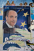 The face of Neapolitan politician Fillippo Piccone on a European elections poster in Naples, Italy. Across the states of the EU, local and MEP elections were staged on 25th May 2014, allowing the electorate to vote for their favoured representatives in Brussels.