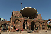 Exterior of Coventry Cathedral also known as St Michaels, a 14th-century Gothic church, and the modern St Michaels Cathedral on 23rd June 2021 in Coventry, United Kingdom. The Cathedral Church of Saint Michael, commonly known as Coventry Cathedral, is the seat of the Bishop of Coventry and the Diocese of Coventry within the Church of England. The cathedral lies in ruins and remains a ruined shell after its bombing during the Second World War.