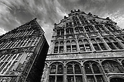 Looking up at the traditional stepped-roof buildings in the old town of Ghent, in the East Flanders region of Belgium