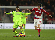 Roberto Firmino of Liverpool tussles with Marten de Roon of Middlesbrough during the English Premier League match at the Riverside Stadium, Middlesbrough. Picture date: December 14th, 2016. Pic Simon Bellis/Sportimage