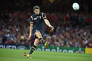 Dan Biggar of Wales kicks a conversion. Rugby World Cup 2015 pool A match, Wales v Fiji at the Millennium Stadium in Cardiff, South Wales  on Thursday 1st October 2015.<br /> pic by  Andrew Orchard, Andrew Orchard sports photography.