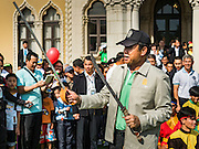 09 JANUARY 2016 - BANGKOK, THAILAND: PRAYUTH CHAN-O-CHA, the Prime Minister of Thailand, walks through crowd  with Thai martial arts weapons during Children's Day festivities at Government House. National Children's Day falls on the second Saturday of the year. Thai government agencies sponsor child friendly events and the military usually opens army bases to children, who come to play on tanks and artillery pieces. This year Thai Prime Minister General Prayuth Chan-ocha, hosted several events at Government House, the Prime Minister's office.       PHOTO BY JACK KURTZ
