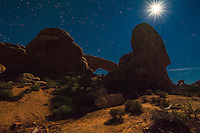 One of the 2000+ arches found in the Moab Desert in Arches National Park, lit by an extraordinary moon on a hot summer night.