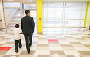 ChaoLin Chang walks with a student at the Mandarin Immersion Magnet School, October 24, 2016.