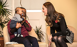 The Duchess of Cambridge makes faces at four month old Gabriel as she talks to his mother Hlengiwe Sithole at the Nelson Trust Women's Centre in Gloucester which is designed to support women who have vulnerabilities, particularly those who have experienced abuse and trauma.