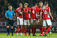 Charlton Athletic players form a wall, Charlton Athletic forward Lyle Taylor (9) looks towards the goalkeeper, during the EFL Sky Bet League 1 second leg Play-Off match between Charlton Athletic and Doncaster Rovers at The Valley, London, England on 17 May 2019.