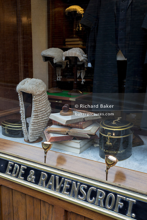 Court dress wigs for the legal profession (barristers and judges) in the window of Ede & Ravenscroft, on 15th February 2017, in London, United Kingdom.
