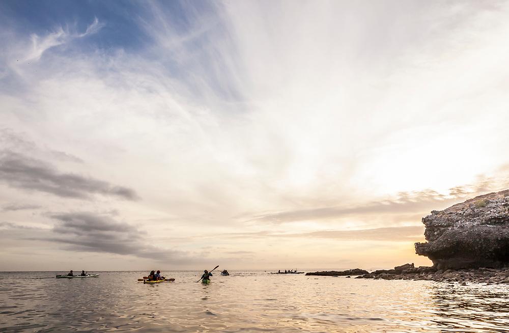 Kayaker silhouettes, Isla Espiritu Santo, BCS, Mexico. The Gulf of California