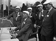 New Facilities At Emerald Star Line.   (R59)..1987..08.06.1987..06.08.1987..8th June 1987..the Minister for Transport and Tourism, Mr John Wilson TD opened a new Customer Service Facility at Emerald Star Line,Carrick on Shannon. Following the viewing of the facility and the planting of a commemorative tree, the Minister, accompanied by Mr Brian Slowey,Managing Director, Guinness,Ireland and Mr E H Bodell, Chairman, Emerald Star line departed on a cruise of The Shannon aboard an Emerald Star Cruiser...Image shows the Minister for Transport and Tourism, Mr John Wilson TD, moving a cruiser out onto the Shannon watched by; MR E H Bodell, Chairman,Emerald Star Line, Mr Brian Slowey, M D, Guinness Ireland,Mr Michael Mc Donnell,Asst Sec, Dept of Tourism and Mr John Ellis TD, Chairman,Leitrim, Co Council