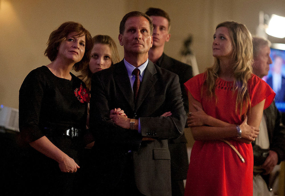 Republican 2nd Congressional District candidate Chris Stewart, center, comforts his wife, Evie, left listening to Mitt Romney's concession speech at the Utah Republican Party results party, Tuesday, Nov. 6, 2012.