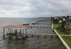 October 10, 2018 - St. Petersburg, Florida, U.S. - A look at the sea wall and docks on Shore Acres in St. Petersburg before high tide as Hurricane Michael passing offshore as it head to the Florida panhandle on Wednesday. (Credit Image: © Dirk Shadd/Tampa Bay Times via ZUMA Wire)