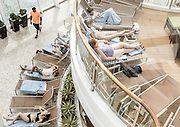 "Royal Caribbean, Harmony of the Seas, The adults-only Solarium features a three-deck high, glass-paneled enclave designed with seating on various ""islands"" surrounded by water, providing guests with the sensation of floating on air. The open-air Solarium offers a tranquil swimming pool, two serene whirlpools, and four cantilevered whirlpools suspended 136 feet (41.5 meters) above the ocean."