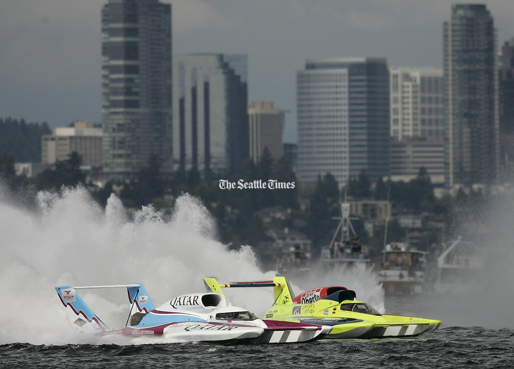 Dave Villwock, of Auburn, driving the Spirit of Qatar, passes Brian Perkins, of Black Diamond, in the Miss Peters & May boat, before finishing second at the Albert Lee Cup at Seafair in Seattle on Sunday, August 8, 2010. (Seattle Times staff photographer)