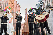 A mariachi band dressed as skeletons for the Day of the Dead festival perform in the Jardin Principal October 28, 2016 in San Miguel de Allende, Guanajuato, Mexico. The week-long celebration is a time when Mexicans welcome the dead back to earth for a visit and celebrate life.