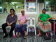 16 MAY 2018 - BANGKOK, THAILAND: The Imam (center) at Masjid (Mosque) Darul Falah,  a small mosque in Baankrua, the oldest Muslim neighborhood in Bangkok, and members of the mosque wait for evening prayers to start on the first night of Ramadan. Based on the sighting of the new moon, Ramadan fasting starts on Thursday, 17 May in Thailand.      PHOTO BY JACK KURTZ