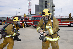 August 3, 2017 - Los Angeles, California, United States - Graduates of the Los Angeles Fire Department Academy during a firefighting demonstration in Los Angeles, California on August 3, 2017. The new firefighters completed a rigorous 20-week training program.(Photo by: Ronen Tivony) (Credit Image: © Ronen Tivony/NurPhoto via ZUMA Press)