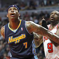 26 March 2012: Denver Nuggets power forward Al Harrington (7) vies for the rebound with Chicago Bulls small forward Luol Deng (9) during the Denver Nuggets 108-91 victory over the Chicago Bulls at the United Center, Chicago, Illinois, USA. NOTE TO USER: User expressly acknowledges and agrees that, by downloading and or using this photograph, User is consenting to the terms and conditions of the Getty Images License Agreement. Mandatory Credit: 2012 NBAE (Photo by Chris Elise/NBAE via Getty Images)