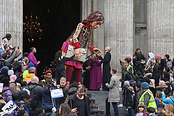 © Licensed to London News Pictures. 23/10/2021. London, UK. Little Amal, the 3.5 metre tall puppet of a nine year old migrant Syrian girl is greeted on the steps of St Pauls Cathedral. The giant puppet has nearly completed a 5,000 mile journey across Europe, aiming to bring attention needs of young refugees and the journeys for a better life. Photo credit: Ray Tang/LNP