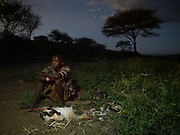 Hunting from a blind for stork, during their migration to Africa. At and near the Hadza camp of Dedauko.