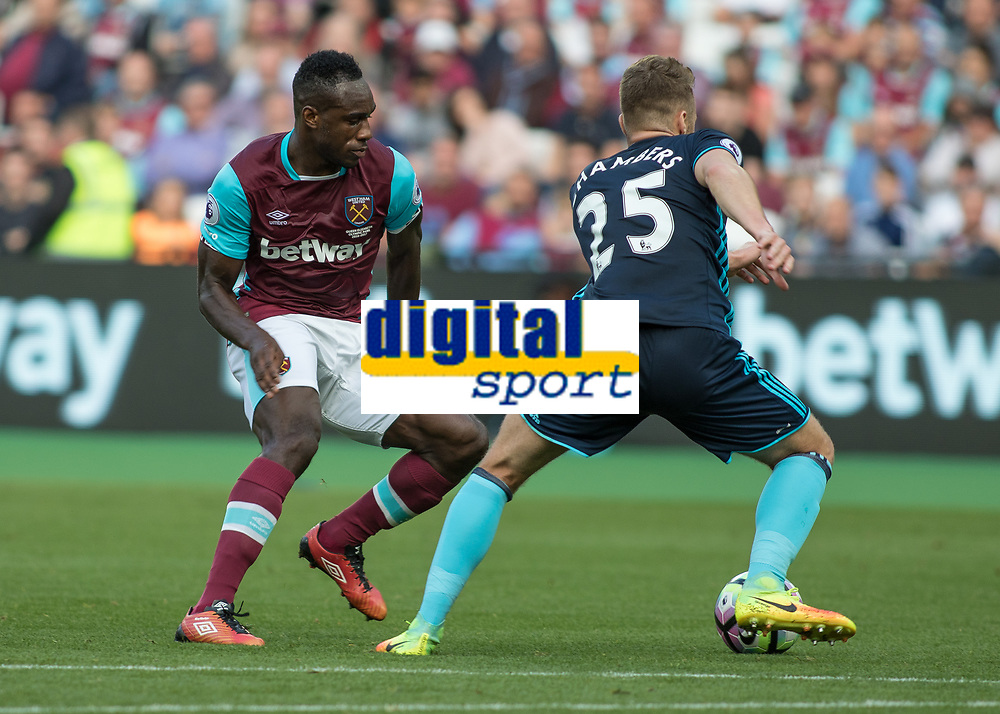 Football - 2016 / 2017 Premier League - West Ham United vs. Middesborough <br /> <br /> Calum Chambers of Middlesborough is closed down by Michail Antonio of West Ham at The London Stadium.<br /> <br /> COLORSPORT/DANIEL BEARHAM