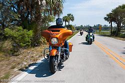 Matt King riding through Tomoka State Park on the Special HOG custom bike project during Daytona Bike Week, FL, USA. March 9, 2014.  Photography ©2014 Michael Lichter.