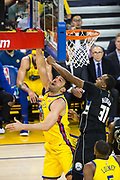 Golden State Warriors center Zaza Pachulia (27) lays the ball into the basket against the Milwaukee Bucks at Oracle Arena in Oakland, Calif., on March 29, 2018. (Stan Olszewski/Special to S.F. Examiner)
