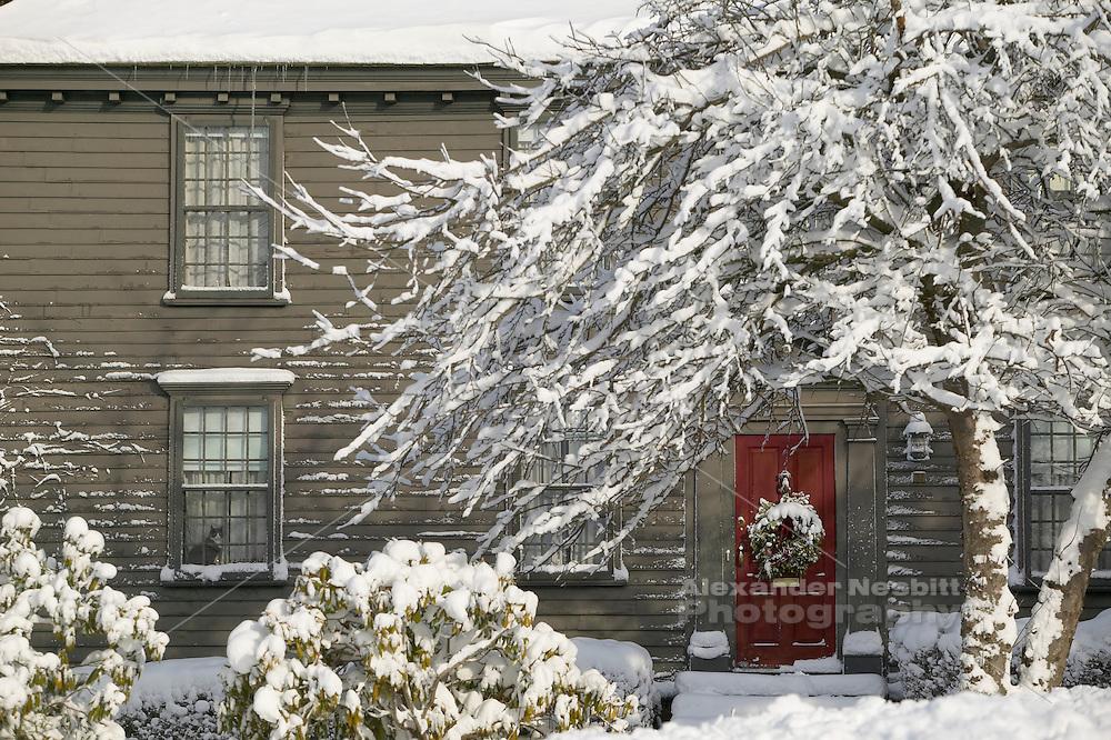 USA, Newport, RI - Winter scene on church street with colonial home and fresh snowfall