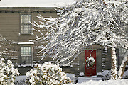 USA, Newport, RI - Winter scene on church street with colonial home and fresh snowfall